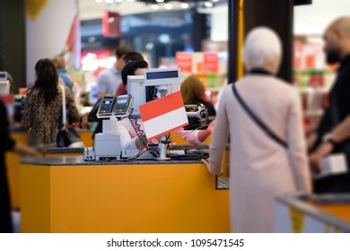 Cash desks with cashier serves customers on blurry background