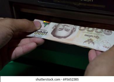 Cash dispenser, cash receiver, cash withdrawal,Banknote Thailand.