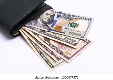 Cash of  dollar note, dollar background. Lot of one hundred dollar bills close-up. dollars in wallet on white background