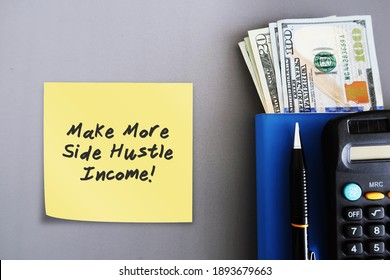 Cash dollars money, calculator, pen, blue notebook, with note written MAKE MORE SIDE HUSTLE INCOME financial planning concept, remind self to make extra more money from side job ,side gig, side hustle