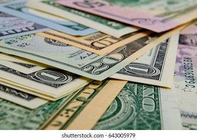 Cash dollars in various denominations on the plane.