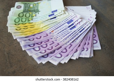 Cash five hundred Euro banknotes spread out on the table.