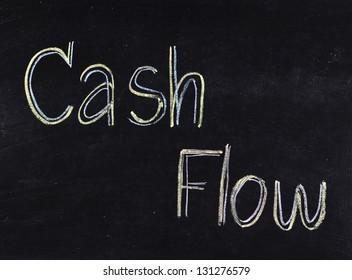 """""""Cash flow"""" handwritten on blackboard"""