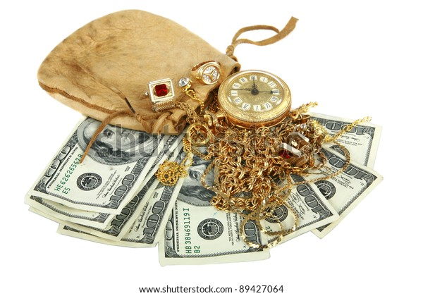 """""""Cash for gold"""" or """"Cash 4 Gold"""" a leather pouch filled with gold jewelry lays upon a pile of cash isolated on white with room for your text. represents CASH FOR GOLD business concepts"""