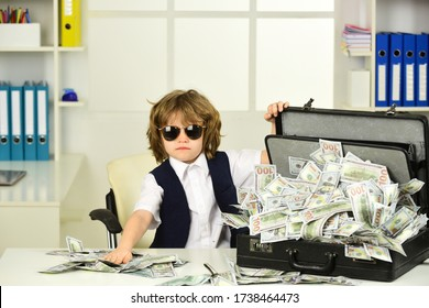Cash. Happy and shoutting arrogant rich kid boy millionaire sits with money dollars cash. Money. Rich people. Savings account