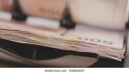 Cash money machine for counting Hong Kong dollar close up