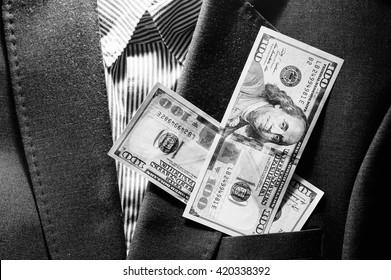 Cash money on the business suit,