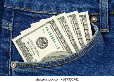 Cash, money is in the pocket of blue jeans. Close up
