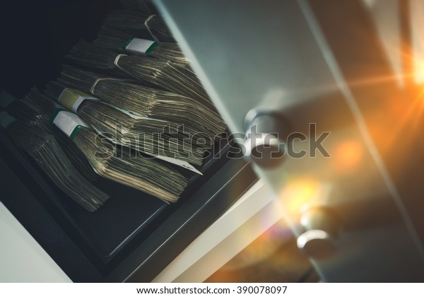 Cash Money Safe Deposit. Small Residential Vault with Pile of Cash Money. Closeup Photo.