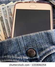 Cash money in US dollar currency and smartphone in the denim blue jeans back pocket, concept of Money Making /Online Business/Side hustle/ Young business owner
