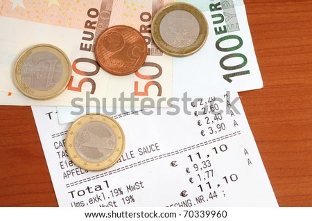 cash receipt on brown table stock photo edit now 70339960