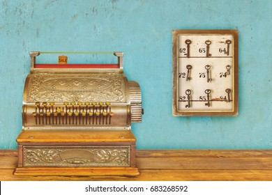 Cash register and cabinet with hotel keys and room numbers on a blue eroded background