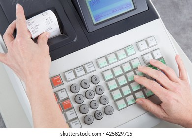 Cash Register and euro money in the till