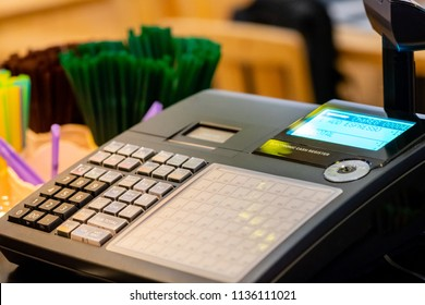 cash register installed on counter for accepting order from customer.sales man entering amount on electronic cash register in coffee shop and retail store.restaurant cashier typing on cash register.
