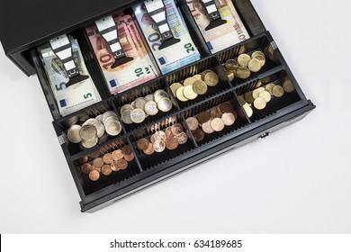 Cash register with money