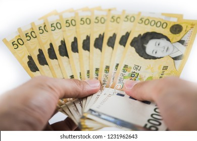 Cash of South Korea won money bills. South Korean won currency and financial planning. Cash management. How to plan saving for retirement. Investment in Korea exchange. Background texture.