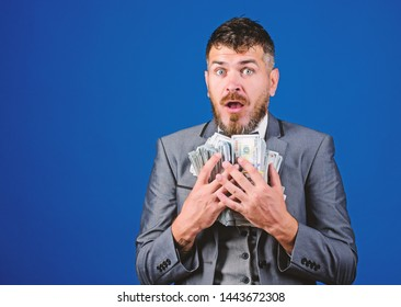 Cash transaction business. Man happy winner rich hold pile of dollar banknotes blue background. Win lottery concept. Easy cash loans. Businessman got cash money. Get cash easy and quickly.