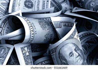 Cash US dollars of various dostoistva on a light background.