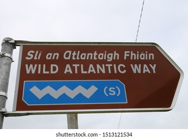 Cashel, County Galway, Ireland.  September 5, 2019.  A bilingual tourist sign pointing the Wild Atlantic Way in a southerly direction.