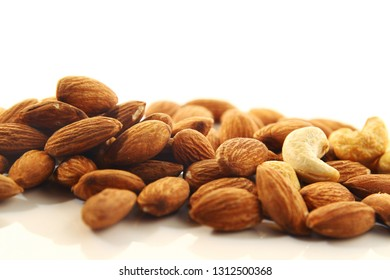 Cashew and almond on white background