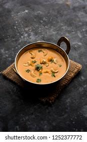 Cashew Curry / Indian kaju masala served in a bowl or pan. selective focus
