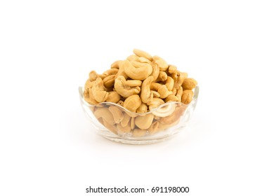 cashew nuts in glass bowl on white background.