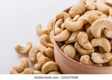 cashew nuts on a white acrylic background