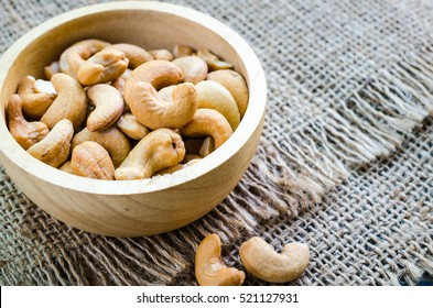 cashew nuts salted and roasted in wooden bowl