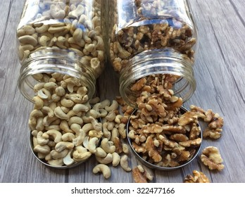 Cashews and Walnuts spilling out of jars