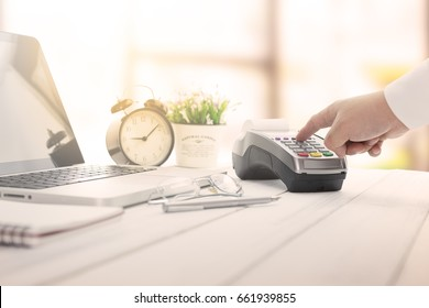 Cashier hand over EDC machine or credit card terminal to made an online payment.