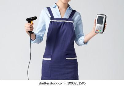 cashier lady with apron holding the edc machine isolated on white background