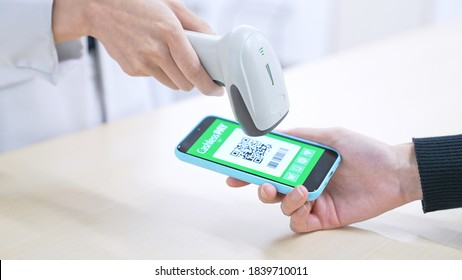 Cashless payment concept. Payment with smartphone app. QR code.