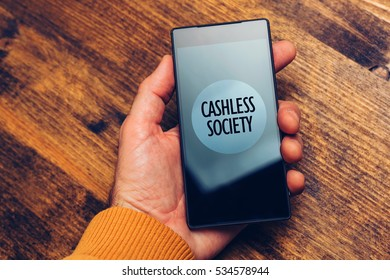Cashless society concept, man using smartphone for electronic payment and online business transactions