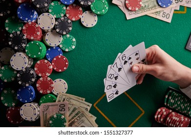 casino background, street flash cards for the player and dollars and chips on the poker table. Gaming business, success. With space for design. Online casino, online poker.