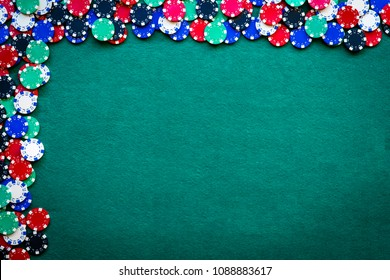 casino chips border background on green table with copy space