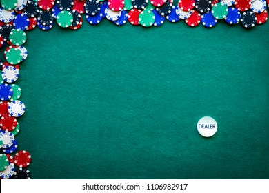 casino chips border background on green table with copy space and dealer chips
