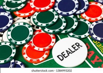 Casino chips and cards on green table with copy space