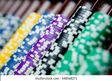 Casino chips colorful gaming pieces lie on the game table in the stack