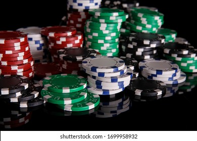 Casino chips isolated on black background