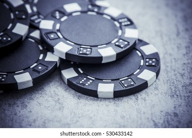 Casino chips pile for gambling and betting in poker. Symbol of luck, chance, winning money and entertainment.