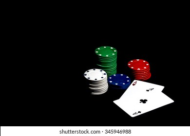 Casino chips, playing cards isolated on black background