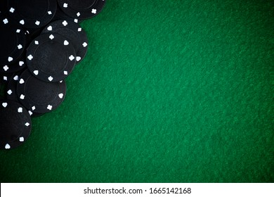Casino chips stacking on a green felt.