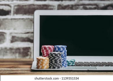 Casino coins and laptop