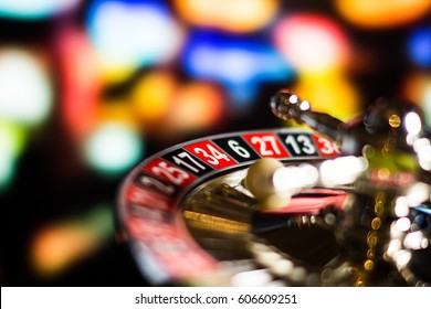 Casino Concept background with dice, golden coins, cards, roulette and chips.Place for typography