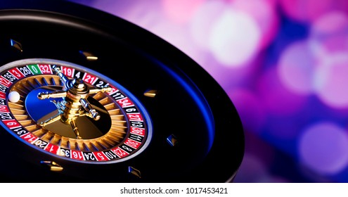 Casino concept. High contrast image of casino roulette, poker chips, dice. Blue light and place for text.