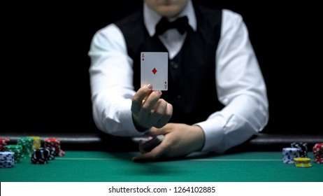 Casino croupier showing ace card in front of camera, poker game shuffling tricks