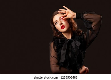 casino gambling. craps or other card games lucky woman with red lips is holding a red dice  in her hands. Red dice