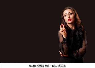 casino gambling. craps or other card games. lucky woman holding in hand a red dice with the number three. Red dice. red lips makeup - Image