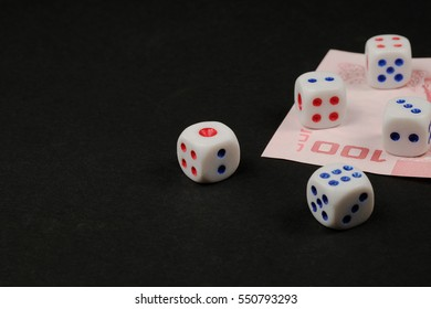 casino, gambling and fortune concept - close up of white dice and cash money