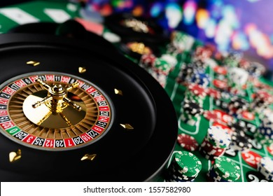 Casino, gamling and entertainment theme. Poker chips, roulette wheel, cards and dice games.